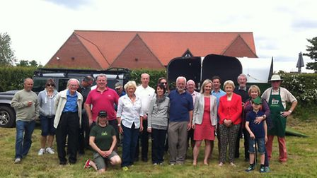 Elizabeth Truss MP with members of the Garboldisham Fox Community Interest Company, councillors and
