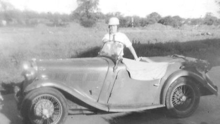 Tony O'Loughlin, complete with crash helmet, and his first car, a 1933 Singer Le Mans.