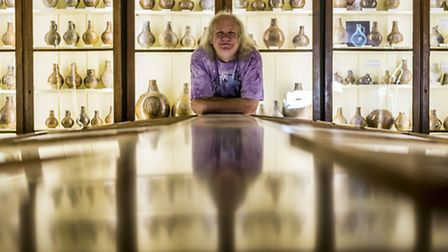Alex Wright and his collection of Bellarmine and German stoneware in Swaffham - Alex in his museum o