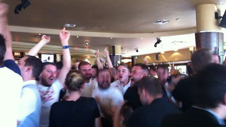 England fans celebrate Daniel Sturridge's late winner against Wales in the Queen of Iceni
