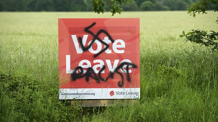 The Vote Leave campaign sign which was defaced with a Nazi Swastika and Racist spray painted on it o