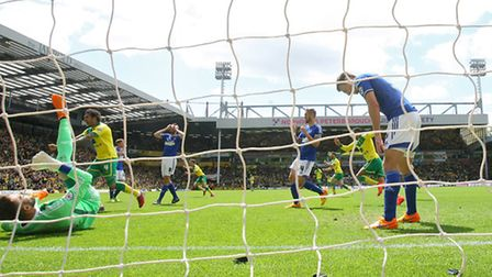 Norwich City players celebrate Nathan Redmond's goal against Ipswich Town in the Championship play-o