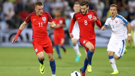 Jamie Vardy (left) and Adam Lallana couldn't get passed the Slovaks either. Photo: Owen Humphreys/PA