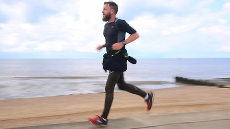 Wayne Russell, here pictured in Heacham, is running around the British coast for charity. Picture: I