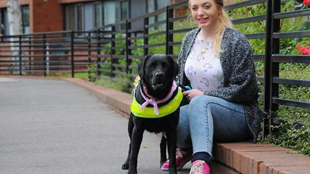 Ruby Blyth-Smith, 21, who is visually impaired, with her guide dog Ziggy. Photo: Steve Adams