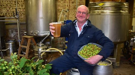 Simon Barker at his micro-brewery at Salle, the All Day Brewing Company, with the green hops from hi