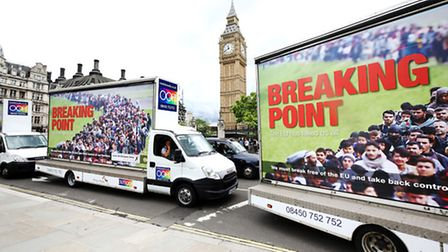 Vans showing the new Ukip EU referendum poster drive past Big Ben in London, for the launch of the p