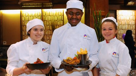 City College students take over the Library Restaurant. Three of the student chefs, from left, Jade