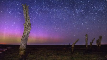 A hint of aurora over the stumps at Thornham Harbour. Picture: Matthew Usher.