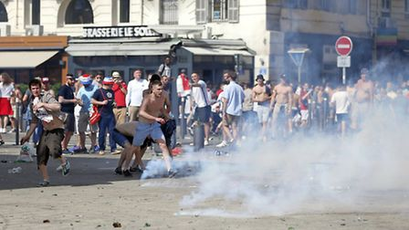 Teargas is fired at England supporters in downtown Marseille, France, Saturday, June 11. (AP Photo/D