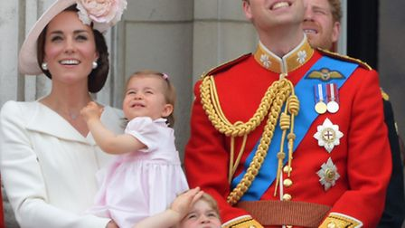Queen Elizabeth II joins members of the royal family, including the Duke and Duchess of Cambridge wi