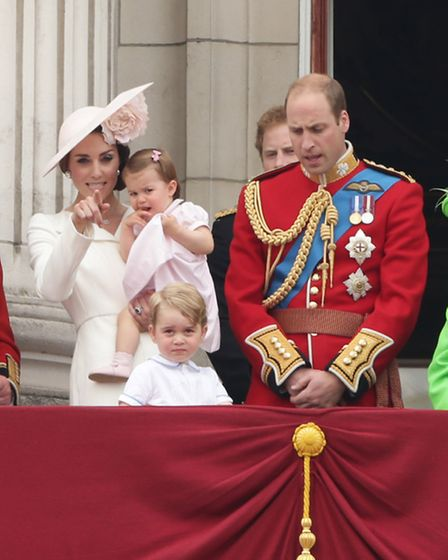 The Duke and Duchess of Cambridge with their children Princess Charlotte and Prince George, on the b