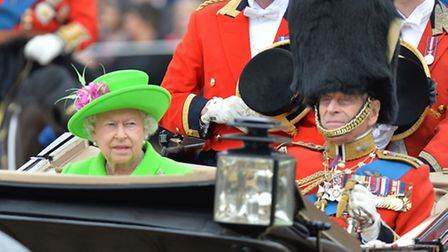 Queen Elizabeth II and the Duke of Edinburgh arrive in a carriage during the Trooping the Colour cer