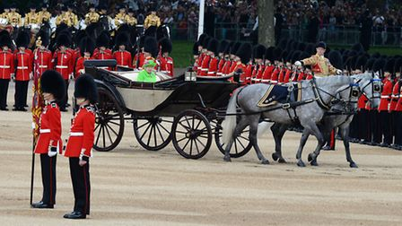 Queen Elizabeth II and the Duke of Edinburgh arrive by carriage for the Trooping the Colour ceremony