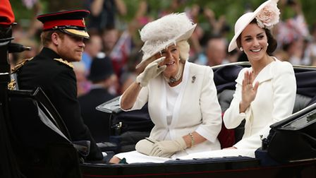 Prince Harry, the Duchess of Cornwall and the Duchess of Cambridge in a carriage as the royal proces