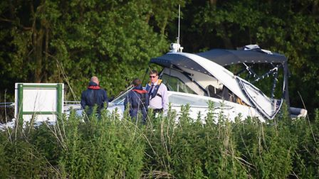 Police, fire and rescue, and the coastguard at the boat on Wroxham Island on the River Bure where tw