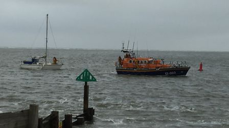 The yacht Jenny is towed to safety by the RNLI.