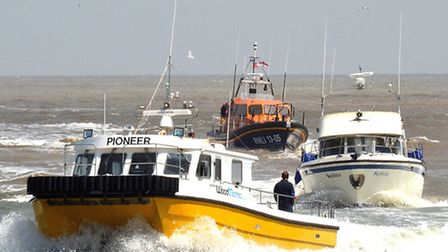 The Pioneer and Lowestoft Lifeboat escort the motor cruiser back into Lowestoft. Picture: MICK HOWES