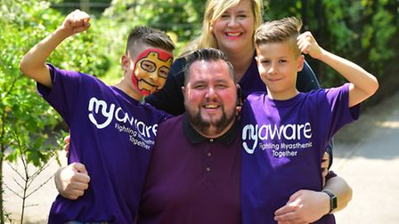 Fundraising walk by Stuart Everett's family and friends. Stuart with his wife, Lyndsay and children