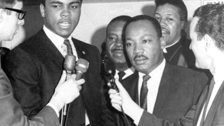 Heavyweight champion Muhammad Ali, center left, confers with Dr. Martin Luther King in this March 29