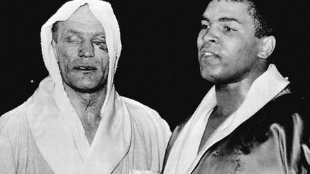 File photo dated 18/6/1963 of Cassius Clay (left), now Muhammad Ali, and Henry Cooper after their fi