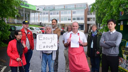 Earlham House traders hold a demonstration about the parking management of their car park, which the