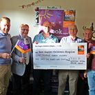 The satellite group presents the EACH chequeWymondham rotary