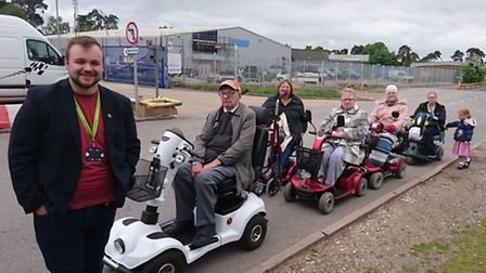 Terry Jermy, county councillor for Thetford West, with scooter users in Thetford who have experience