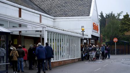 """Shoppers wait outside Sainsbury's in North Walsham for the """"all clear"""" following the fire alert. Pic"""