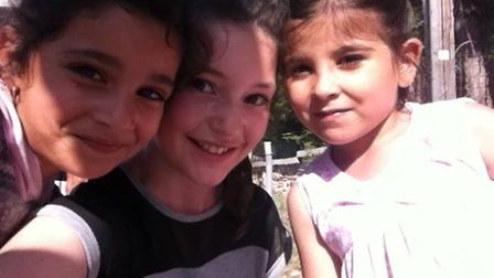 Chiara poses for a selfie with some refugee children who introduced her to their families.