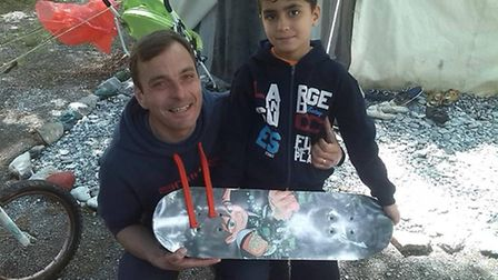 Carmine De Grandis hands out gifts to refugees in their camp in Greece.