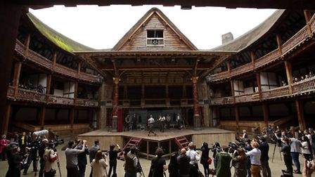 Actors on stage at The Globe, the replica of Shakespeares theatre beside the River Thames in London.