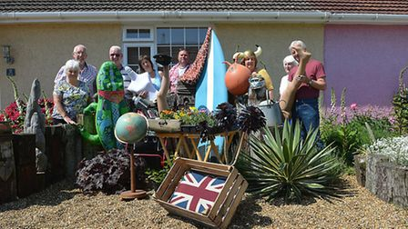 Villagers in Wicken Green with some of the items which will be included in their yard sale to raise