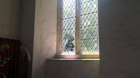 A damaged window at St Mary's Church in Carleton Forehoe, Norwich
