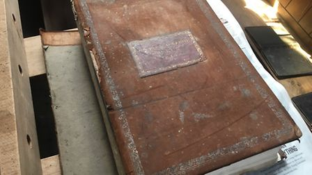 The damaged bible at St Mary's Church in Carleton Forehoe, Norwich