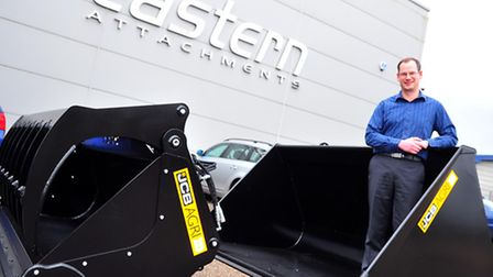 MD of Eastern Attachments in Attleborough, Philip Leslie, outside the head office. The company is mo