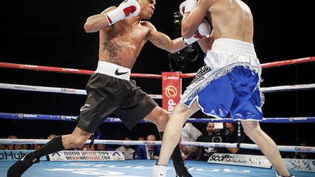 Anthony Ogogo, left, on his way to victory over Gary Cooper in Glasgow. Photo: PA