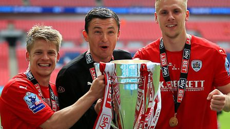 (Left to right) Barnsley's Lloyd Isgrove, caretaker manager Paul Heckingbottom and Marc Roberts cele
