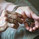 File photo dated 3/4/16 of an elderly woman counting loose change as plans to clamp down on early ex