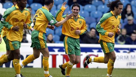 Norwich City's David Healy (second right) celebrates scoring the opening goal against Sheffield Wedn
