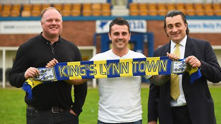 King's Lynn Town's latest summer signing, prolific striker Leon Mettam. Also pictured are manager (L