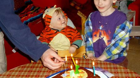 Euan and his brother Finley, 7, get ready to eat cake during Euan's first birthday party.