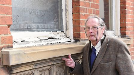 Ian Robb outside the empty Town Hall in Lowestoft. Rotten window frame. Picture: James Bass