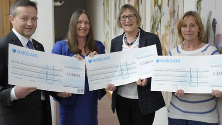North Norfolk District Councillor retiring chairman Annie Claussen-Reynolds presenting cheques to he
