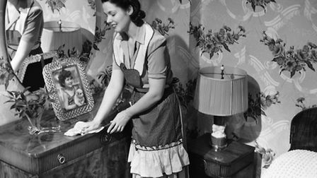A 1950s housewife at work.