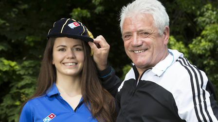Former England football player and manager Kevin Keegan caps new employee Eva Juhasz, as she joins t
