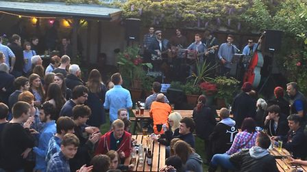 People enjoying themselves at a festival held at the Green Dragon in Wymondham