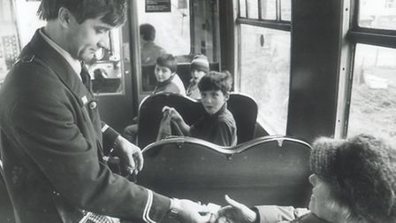 Conductor/Guard Peter Francis collects fares on the Norwich to Sheringham Train pic taken 25