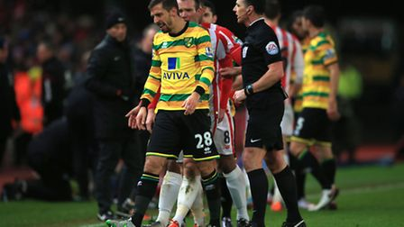 Norwich City's Gary O'Neil (left) leaves the field after being shown a red card by referee Neil Swar