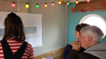 Local residents viewing Waterways plans put up at the Beach Hut on North Drive, Great Yarmouth